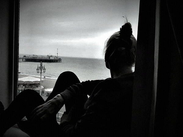 Sarah sat in the window relaxing with the view of the pier