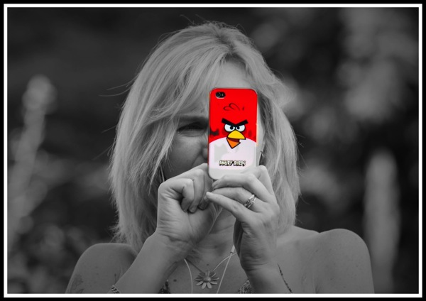 A photo of my lovely wife Sarah taking a photo of me with her iPhone that has a bright red Angry Birds cover