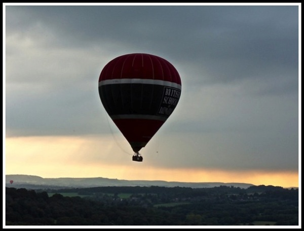 Balloon in flight with sunsetting
