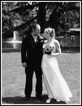 Our most blessed day! A photo of me and Sarah lovingly looking at each other at Bourne Hall.