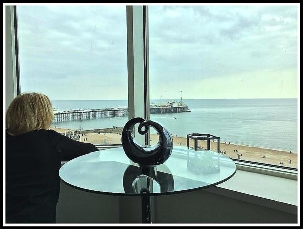 Sarah relaxing looking over brighton pier from her suite window seat 2.jpg