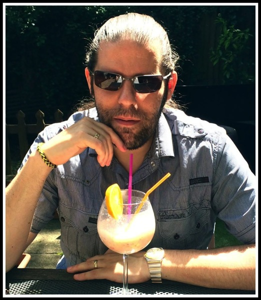 Me relaxing with a refreshing drink in Sicily restaurant garden