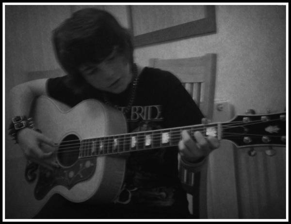 Alfie playing Gibson SJ200