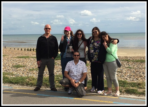 A group photo of us in front of the beach and sea