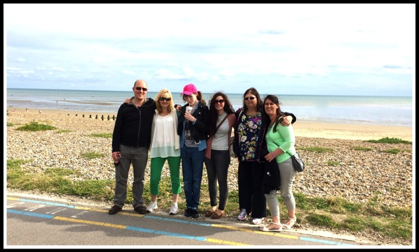 Group photo in front of the beach and sea