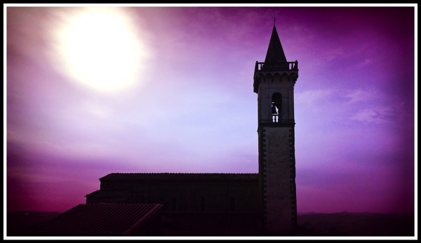 A beautiful bell tower with purple blue sunrise over vince