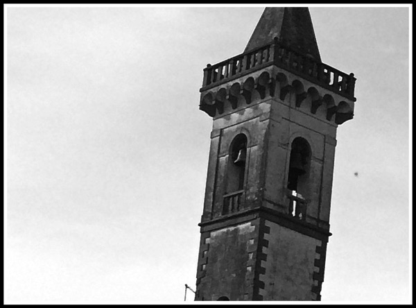 A close up black and white of the Vinci Bell Tower