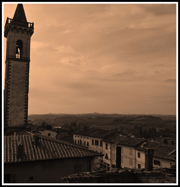 A view overlooking the town of Vinci with a bell tower on the left