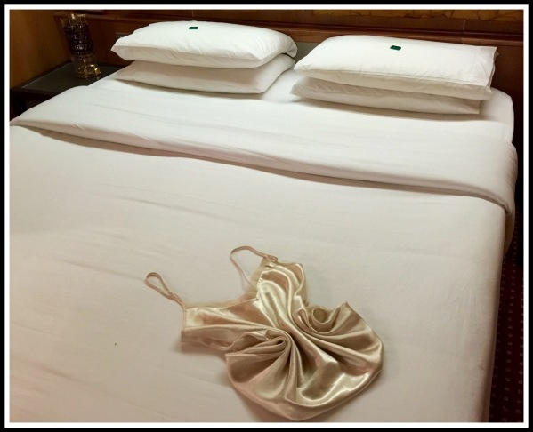 a photo of the folded bed covers and Sarahs Folded Nightie 2