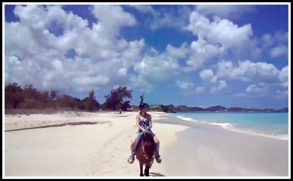Sarah looking out to sea as she rides along the stunning Sandhaven beach