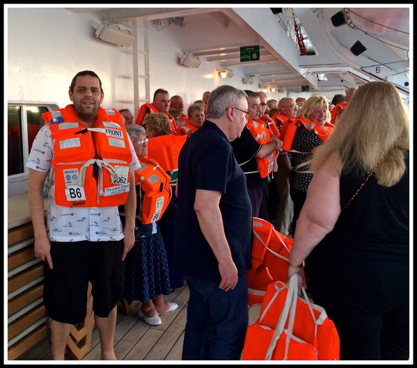 Me in life jacket on the left of the photo, with a lot of other people on deck 9 stood around with life jackets