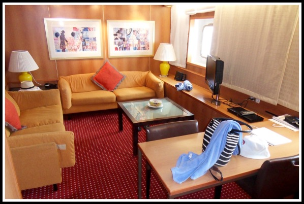 a photo of the lounge area in the suite