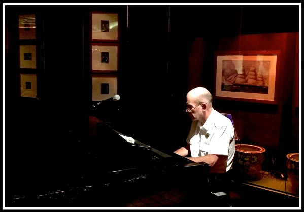 Pianist Keith sat playing at the piano