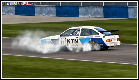 photo of a racing sierra cosworth with smoking tyres doing doughnuts at Donington race track