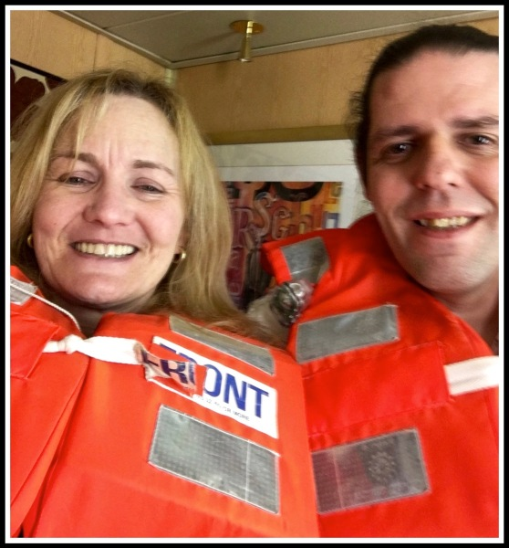 A selfy of Sarah and i wearing our orange life jackets