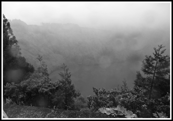 A landscape covered in rain, fog and mist