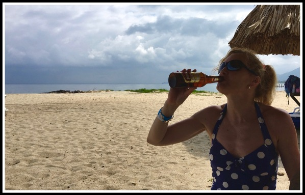 Sarah drinking lager on Trujillo beach