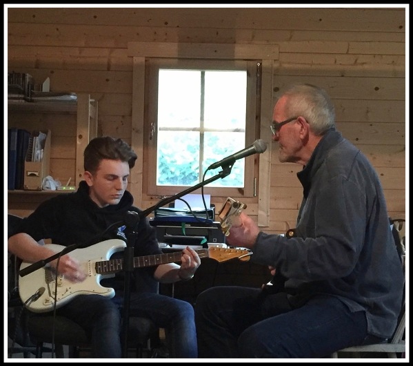 Alfie on the left playing a start with Sarah's Dad(Steve) singing into a mic on the right