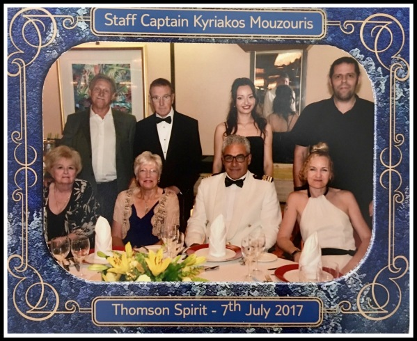 Me stood behind Sarah on the right of the photo stood in front of the staff captains table with 4 other people(including the captain who is sat next to Sarah)
