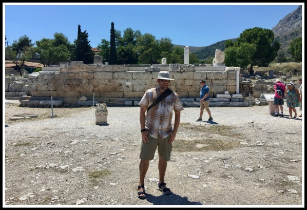 Me stood (centre) in front of the ruins of the Bema in ancient Corinth