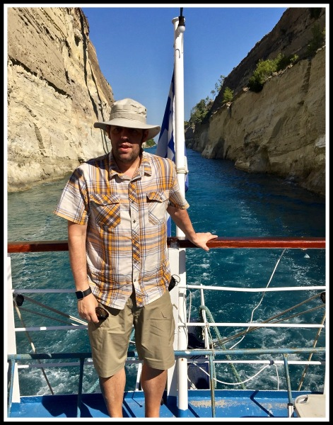 Me stood right at the rear of the boat with the beautiful Corinth canal in the background