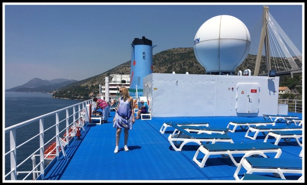 Sarah stood wearing her new Hokusai wave dress on the top deck of the Thomson Sirit  @ Dubrovnik 4.jpeg