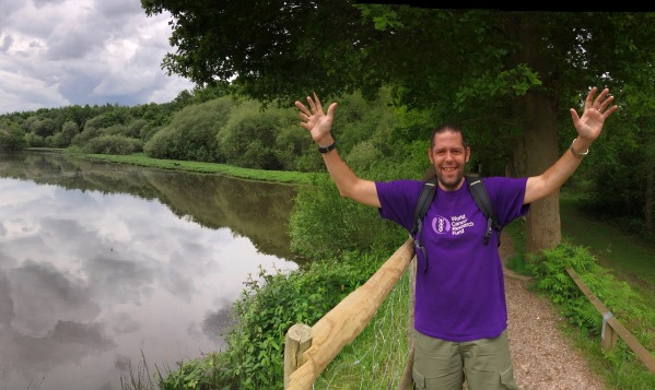 Me waving wearing my World Cancer Research Fund T-Shirt while walking alongside a lake