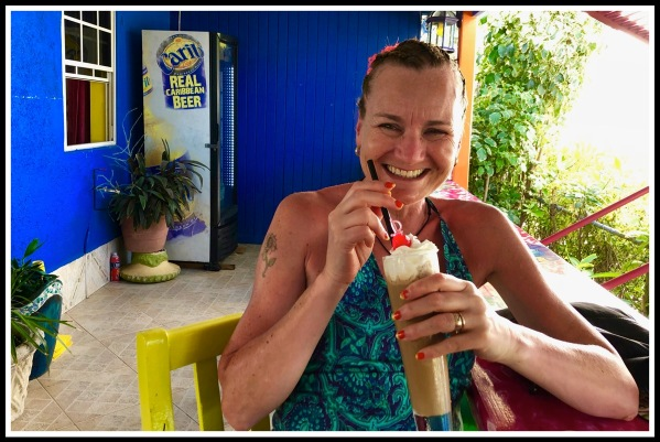 Sarah drinking an iced coffee in Sharkey's Barbados