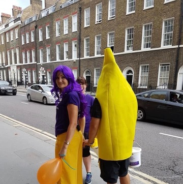 Sarah & i walking away after a morning fundraising.....Me in a banana suit and Sarah with a purple wig and yellow trousers