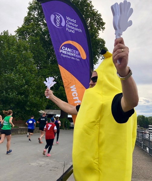Me wearing the bright yellow banana suit and cheering on the runners