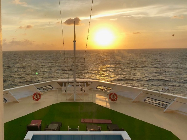 A view of a sunset from our cabin on the Marella Explorer looking directly forward and centre at the front of the ship
