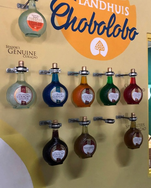 bottles of Curacao hanging on a display wall