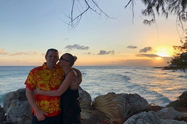 Sarah & i stood in front of the barbados sunset