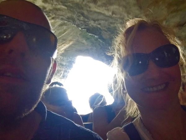 Inside the caves in Corsica with darkness all around and the light in the centre