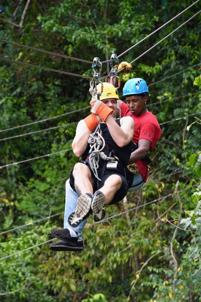 Me on the zip line with te zip line dude attached to me