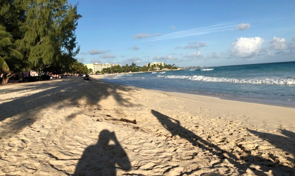 Sarah shadow across the beach looking over the whole bay of Barbados
