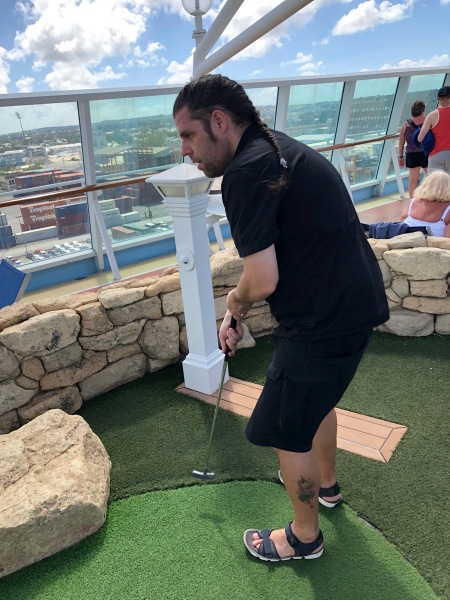 Me playing crazy golf on the top deck of the ship