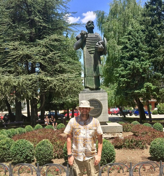 Me stood under a statue in montenegro