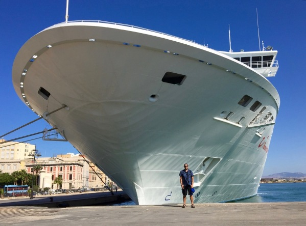ME STOOD UNDERNEATH THE FRONT OF THE SHIP THAT LOOKS HUGE AND IS TOWERING OVER ME