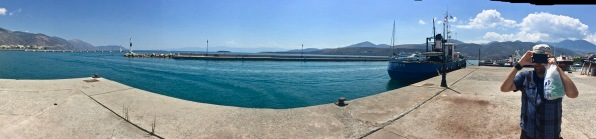 panorama of the whole dock with the sea in the middle and i am over on the right taking a photo with my phone of Sarah