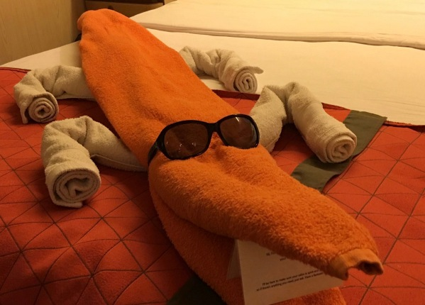 photo of a towel creature lay on the bed