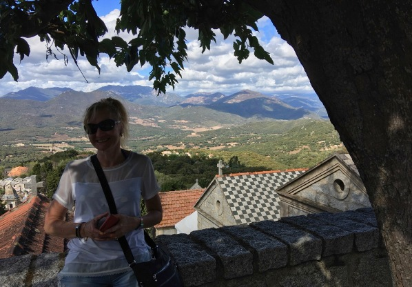 Photo of Sarah under a tree with the Corsica hills in the background