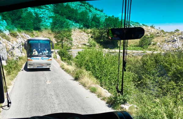 Photo to taken from our front seats in the coach of the very narrow road with a coach facing us and having to reverse