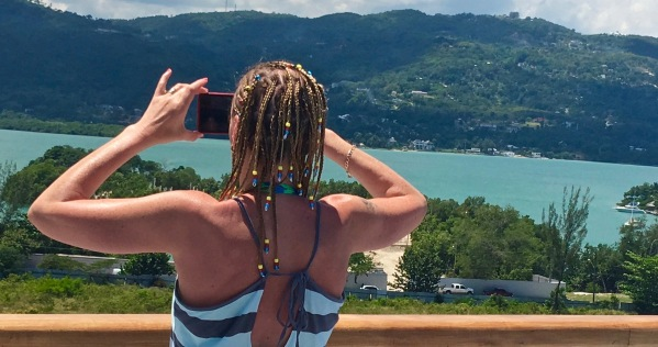 Sarah on the deck with the beautiful Jamaican background behind her