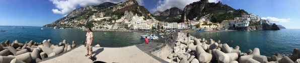 Sarah panorama of the Amalfi sea, road and mountains in the background and me in the centre of the photo