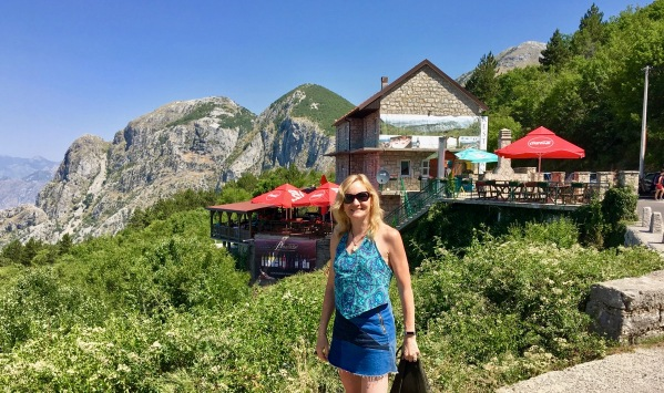 Sarah stood in front of the mountain top bar/restaurant