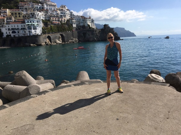 Sarah stood on the edge of the small dock with sea all around her and mountains in the background