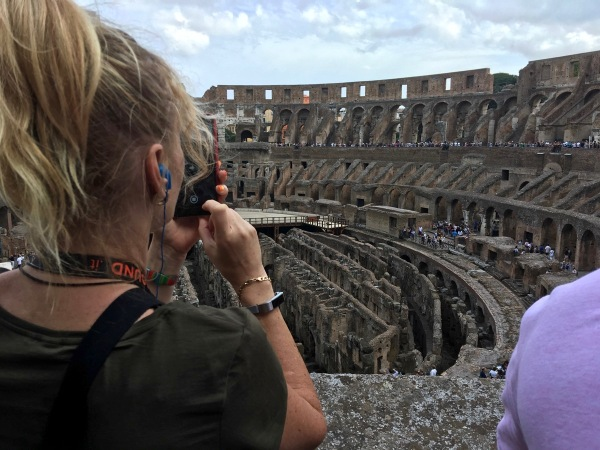 Sarah taking a photo over looking the iside of the Colosseum