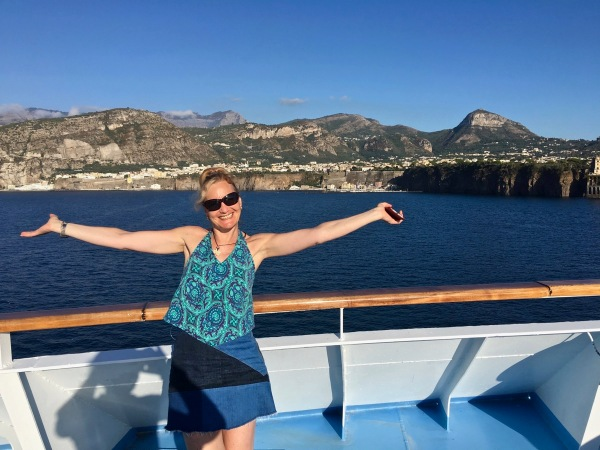 Sarah with arms out stretched welcoming you to Sorrento