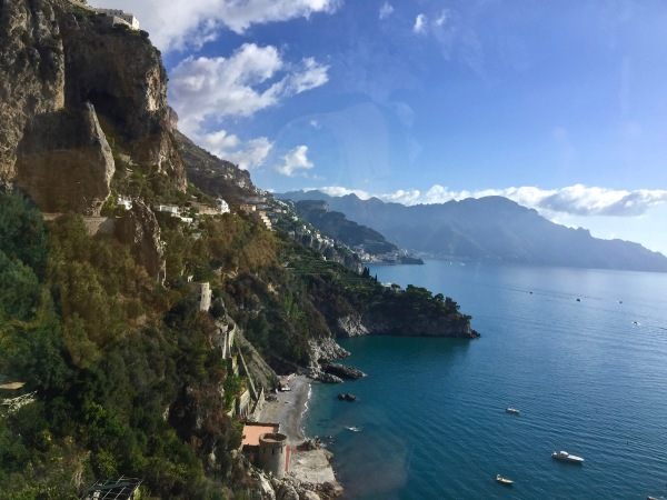 The beautiful Amalfi coast and te town buldings and rolling hills and mountains